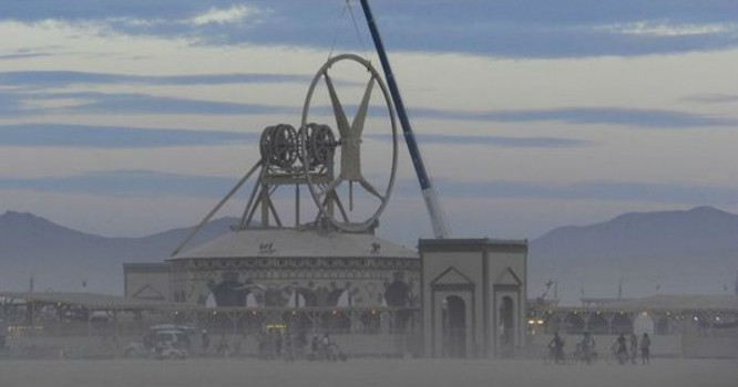 Oops! Burning Man stuck upside-down, without head