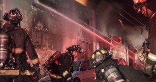 Officials prepare for dozens of fatalities from fire during concert at Oakland warehouse