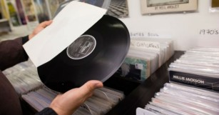 Tables turned as vinyl sales overtake digital sales for first time in UK